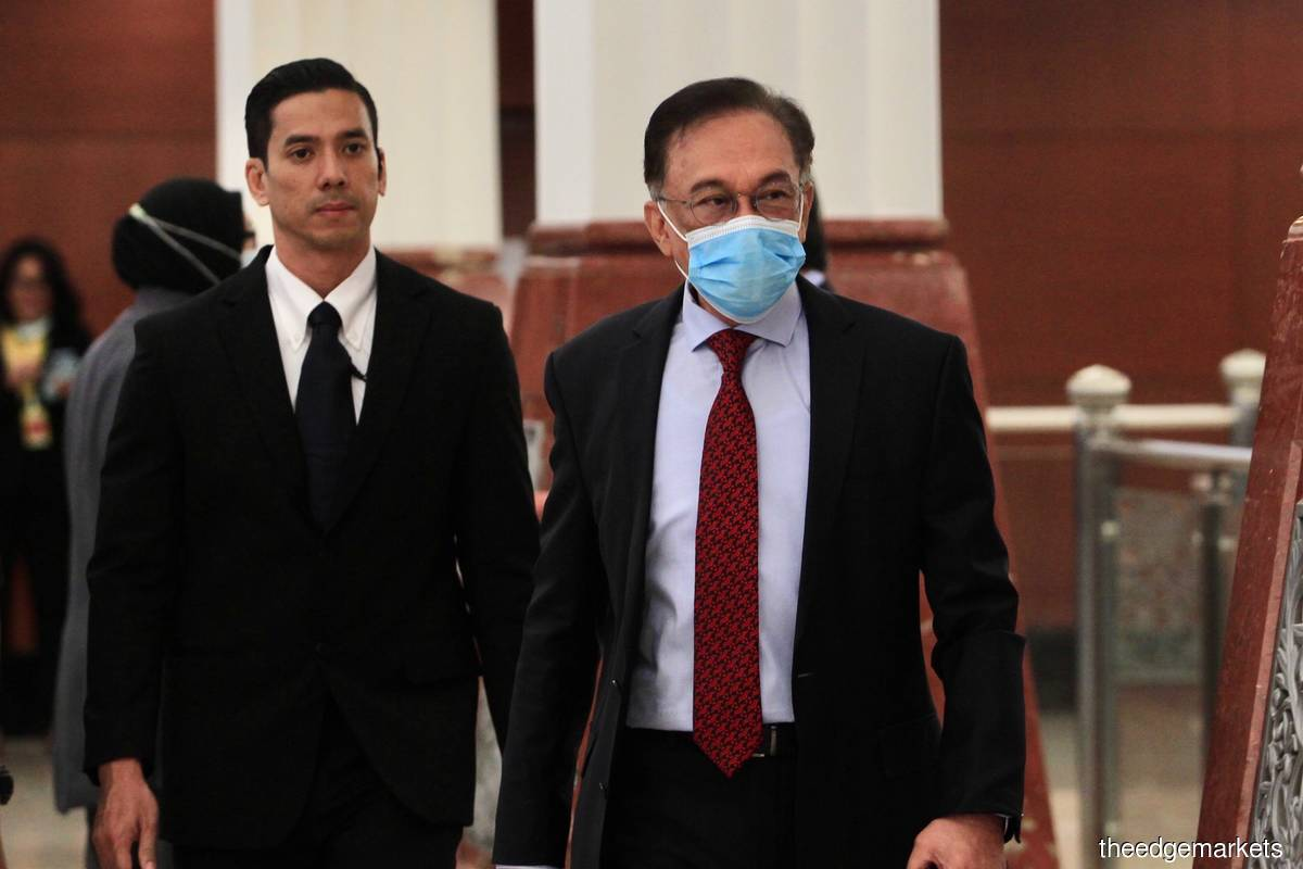 Opposition leader Datuk Seri Anwar Ibrahim (right) at the Parliament today. (Photo by Shahrin Yahya/The Edge)