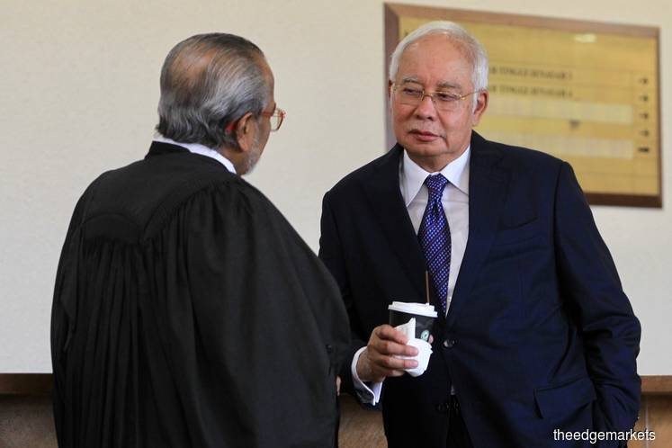 Najib with his counsel Tan Sri Muhammad Shafee Abdullah at the High Court here today. (Photo by Shahrin Yahya/The Edge)