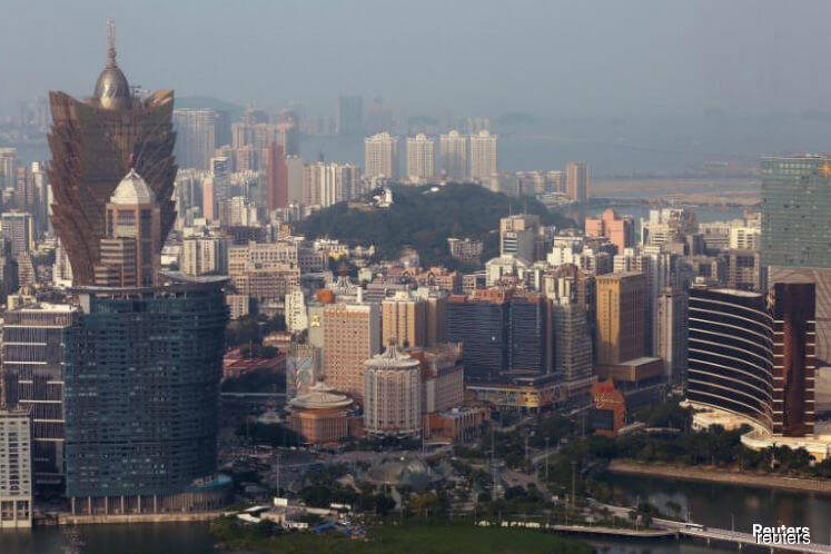 Macau confirms first Wuhan virus case, tightens screening in casinos