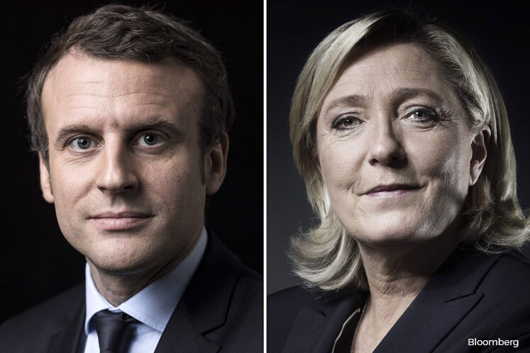 Macron, Le Pen in French runoff as establishment crashes out