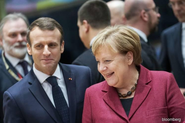 Macron says he would back Merkel for EU post 'if she wants it'