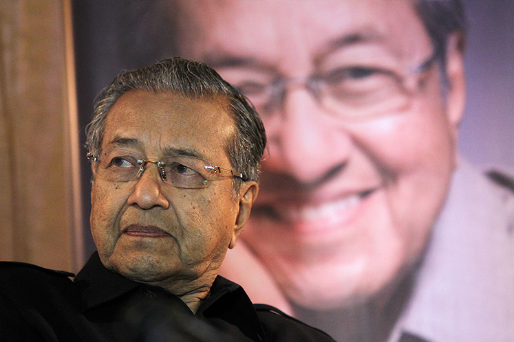 Dr Mahathir vows to put house in order before stepping down
