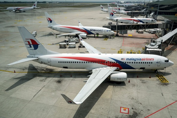 Malaysia Airlines enforces use of face masks on passengers