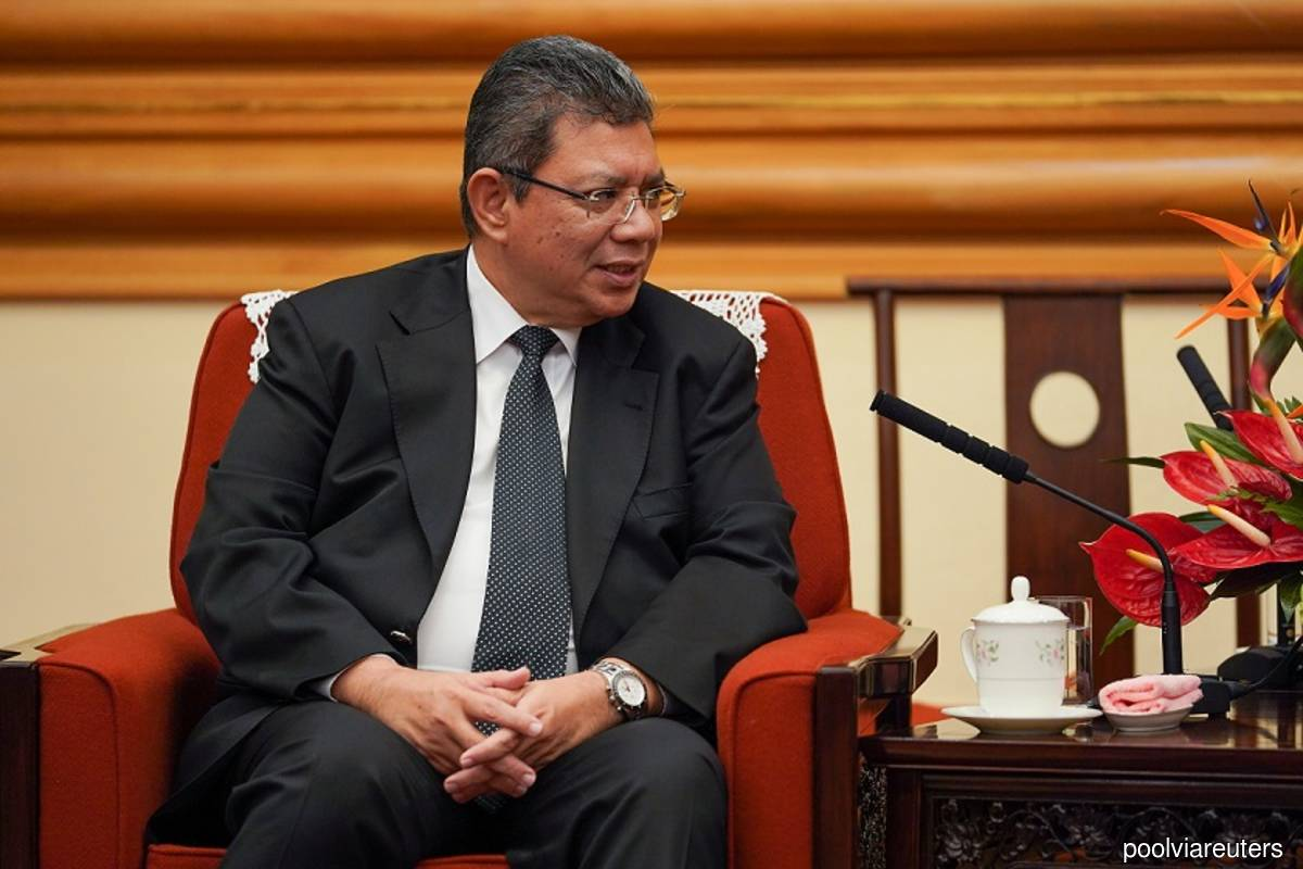 Malaysian Foreign Minister Datuk Saifuddin Abdullah speaks with member of the Politburo of the Communist Party of China Yang Jiechi (not pictured) during a meeting in Beijing, China on Sept 12, 2019. (Photo credit: Andrea Verdelli/Pool via Reuters)