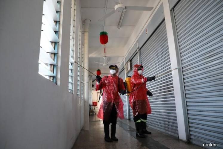 Malaysia mulls buying coronavirus test kits from South Korea as tally rises