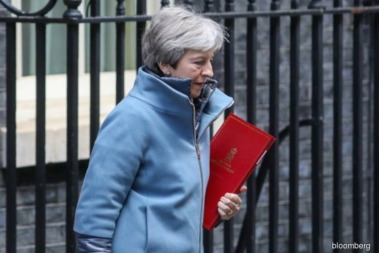 May hints at customs compromise after securing Brexit delay