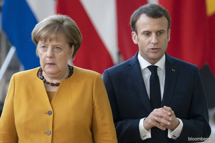 Merkel plays down rift with Macron to defend European unity