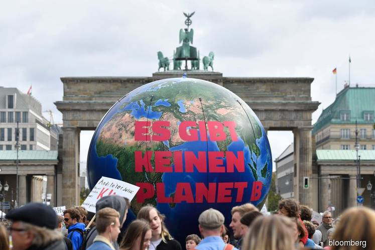 Germany commits €100bn for climate as protests heat up