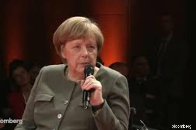 Deutsche Bank merger will be assessed for risks, Merkel says