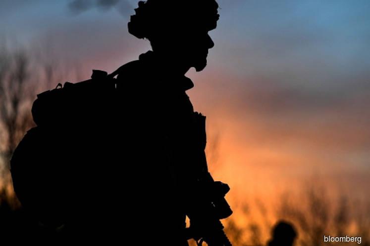 UK seeks military bases in Caribbean and Asia, Telegraph says