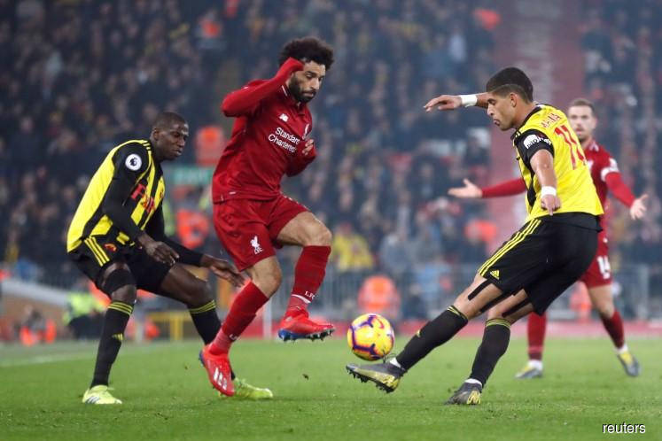 Stylish Liverpool thrash Watford 5-0 to stay top of league