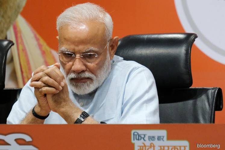'India wins' says Modi as BJP surges to single party majority