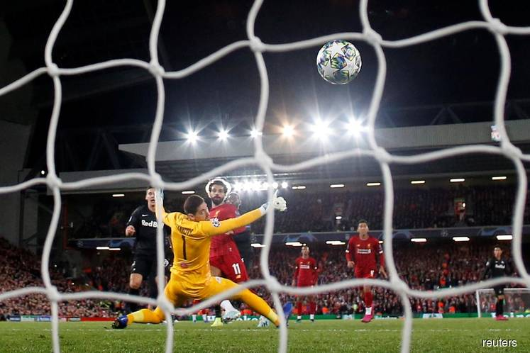 Liverpool win seven-goal thriller after stunning Salzburg fightback