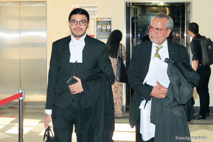 Muhammad Shafee (right) and his son Muhammad Farhan (left) at the High Court yesterday. <em>Photo by Shahrin Yahya</em>