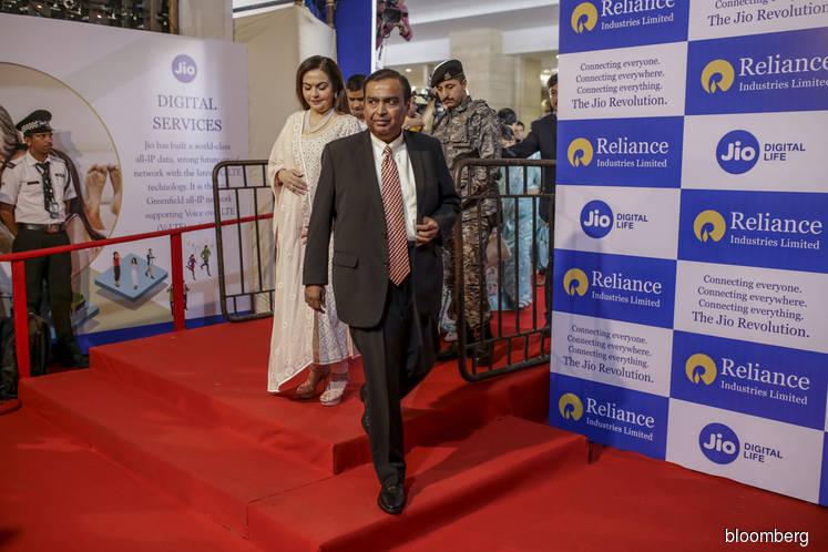 Ambani's plans to make reliance debt-free hit multiple snags