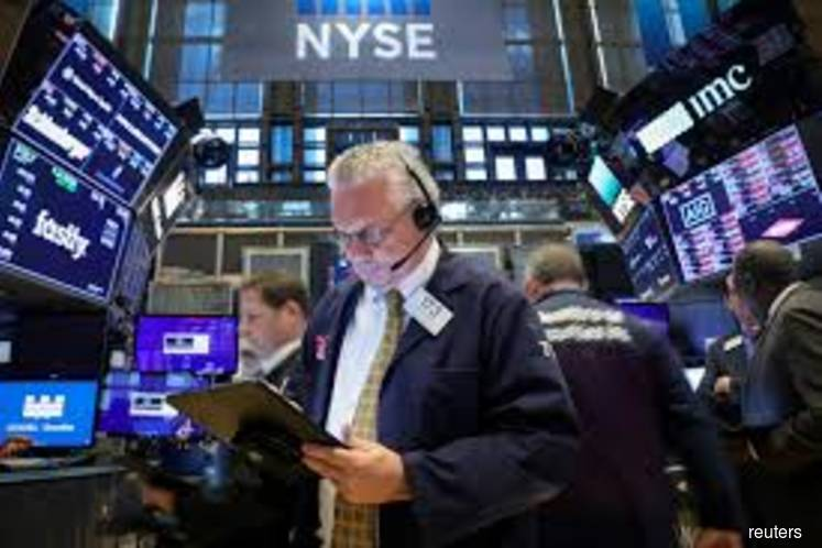 Wall St falls as U.S. crude collapse worsens pandemic woes