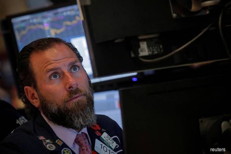 Wall Street ends higher on trade, ECB stimulus hopes