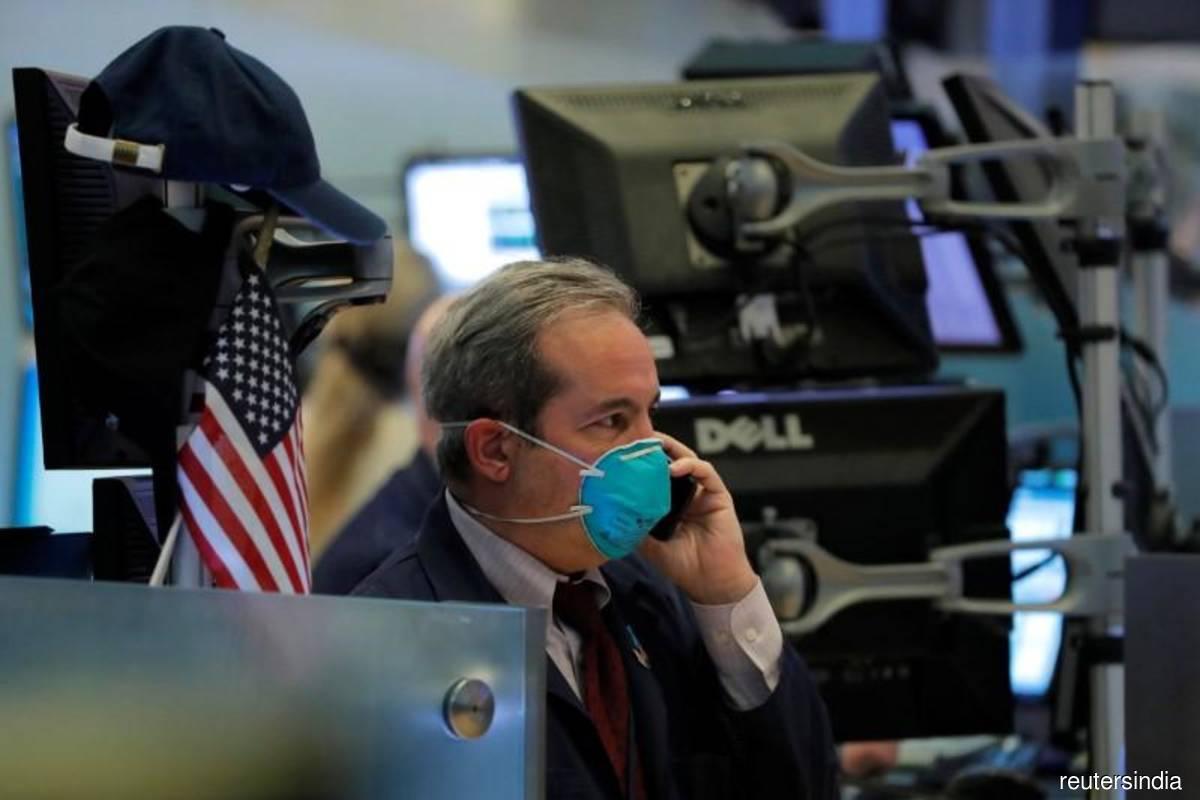 Microsoft, Apple lift Wall St as investors await stimulus