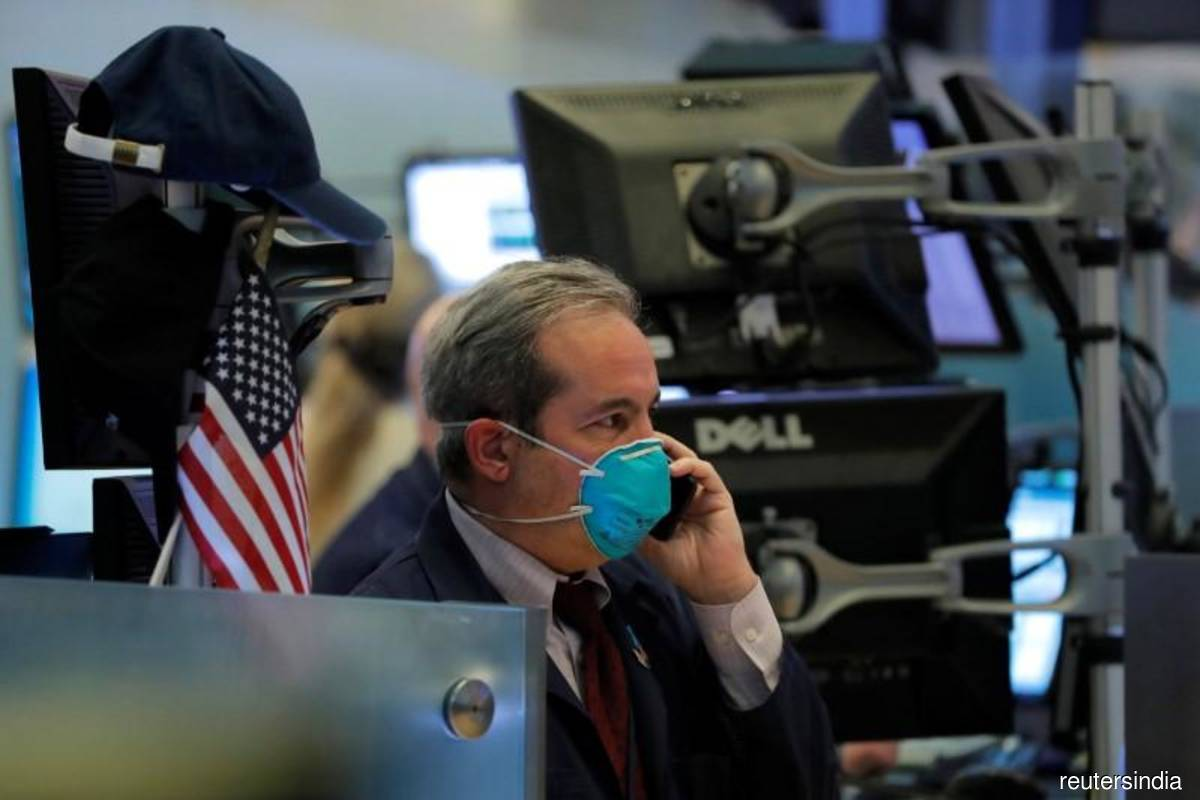 Wall St dips on concerns over fading stimulus, virus fears