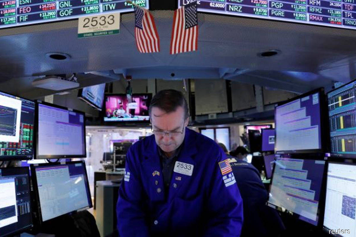 Slowing inflation growth lifts Dow, S&P to records