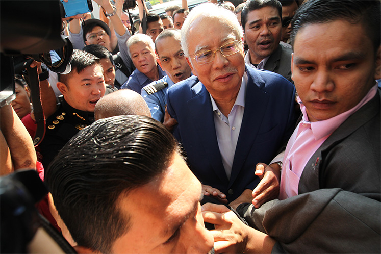 Police confirm Najib's aide lodged police report over his alleged links to murders