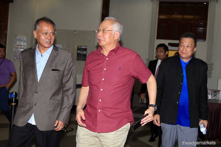 Najib asked to leave after prosecution objects to his presence in court