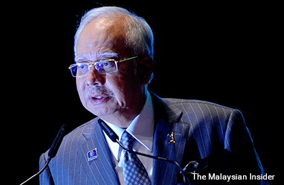 Najib chokes back tears during speech about his father