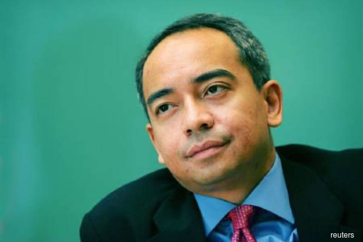 CIMB's Nazir Razak denies exit report