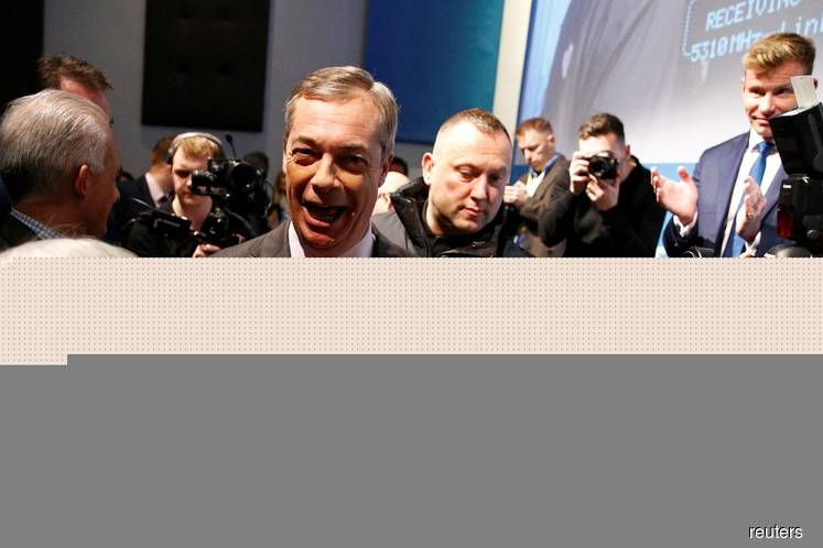 Britain election: Nigel Farage signs contract with voters