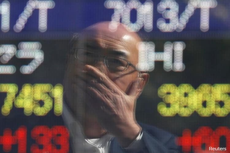 Nikkei ends at month high, softer yen boosts exporters