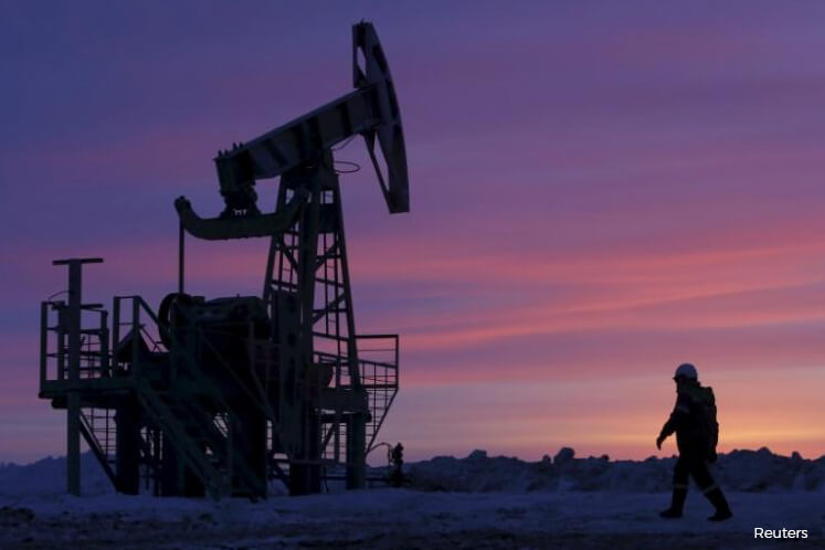 Oil stocks tumble on lowest crude futures since January over supply glut