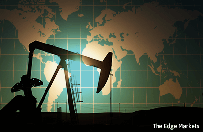 Oil up on Canada wildfire, dollar; big weekly loss for Brent