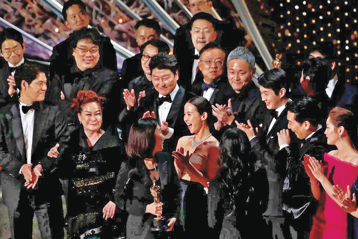 CJ Group vice-chair Miky Lee (front row, second from left), executive producer of Parasite, with director Bong Joon-ho (second row, second from left) and the cast of the South Korean film that made history in February as the first non-English language film to win the Oscar for Best Picture. (Photo by Reuters)