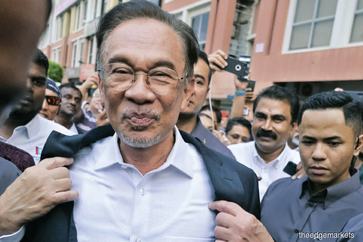 Anwar's supporters are asking why must it always be the PKR leader who must give in? (Photo by Bloomberg)