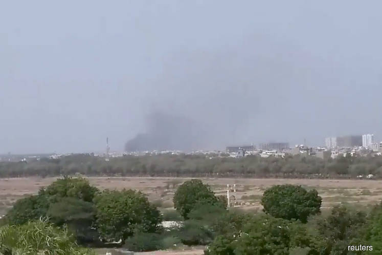 Smoke billowing from the site where a PIA aircraft crashed in Karachi, Pakistan today.