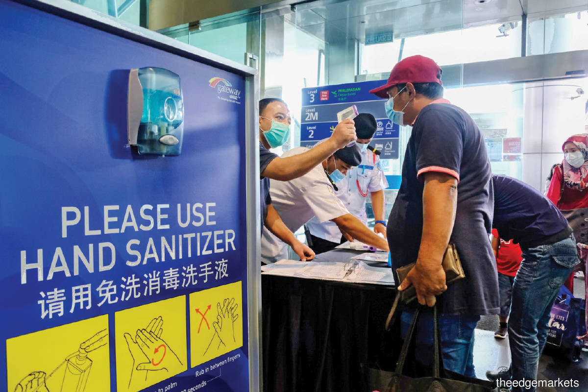 Passengers being tested at klia2. MAHB is understood to be looking at testing as many as 20,000 passengers  — 10,000 each at KLIA and klia2  — on a daily basis,  for a start. (Photo by Bloomberg)