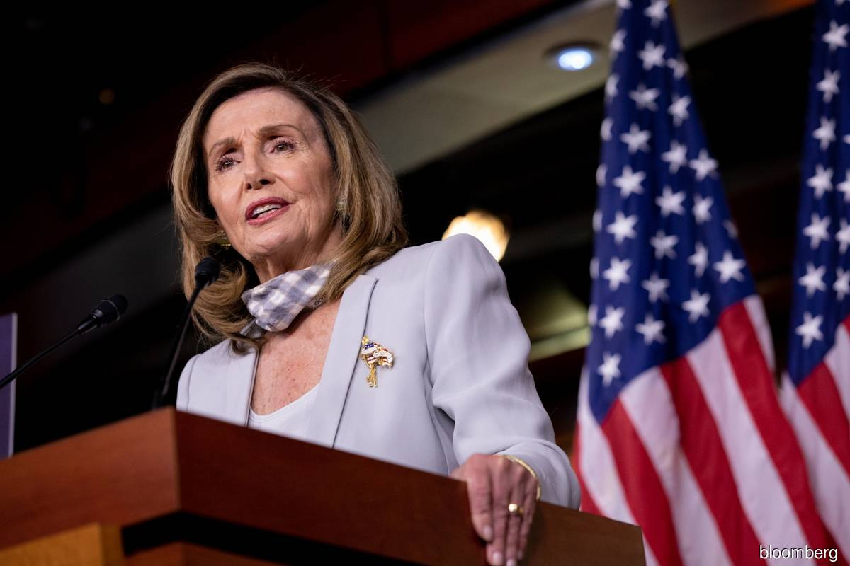 """Pelosi in a letter to Democrats earlier on Friday warned that Trump is so """"unhinged"""" and said that she sought assurances from the nation's top military commander that safeguards are in place in case he initiates an armed conflict or tries to launch a nuclear strike. (Photo by Bloomberg)"""