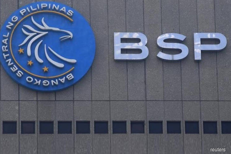 Philippine central bank cuts rates as growth falters, opens door for more easing
