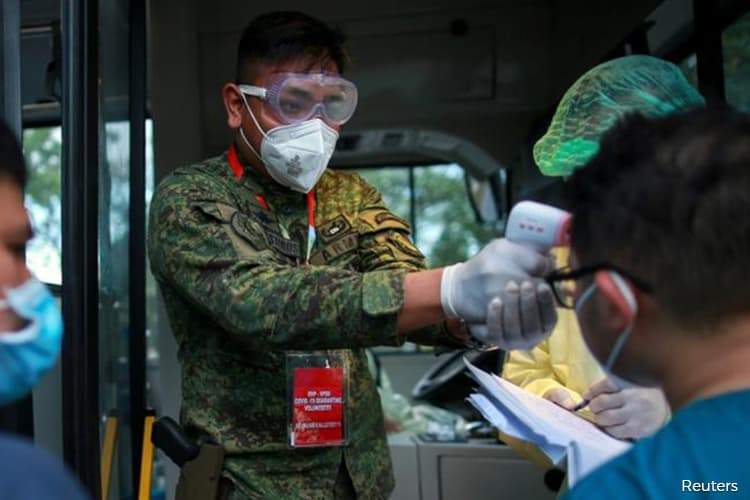 Philippines reports 11 new coronavirus deaths, 322 more infections