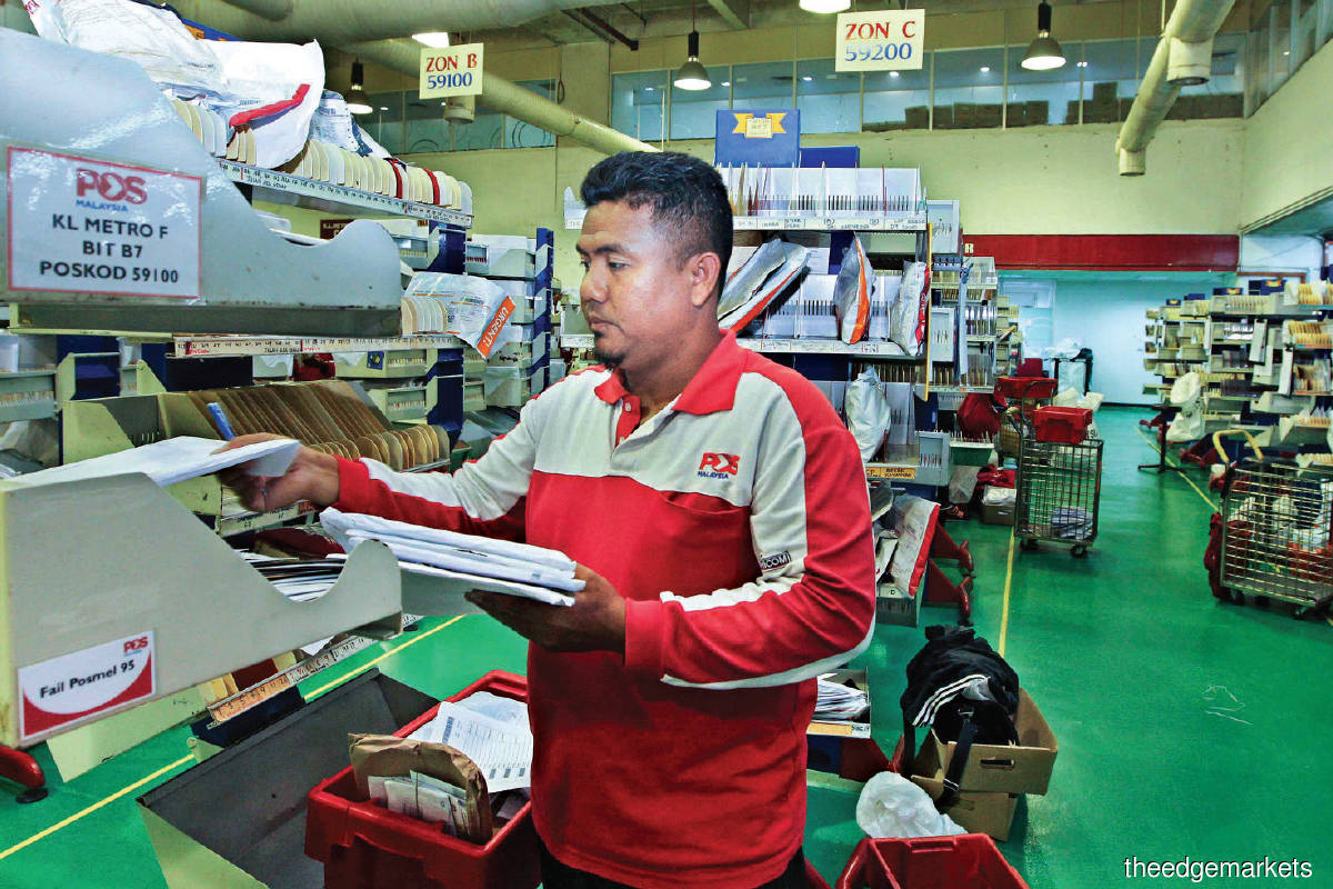 Beginning in 2020, Pos Malaysia combined postal and courier services into one segment. The combined segment reported a loss of RM45.7 million in the half year ended June 30. (Photo by Kenny Yap/The Edge)