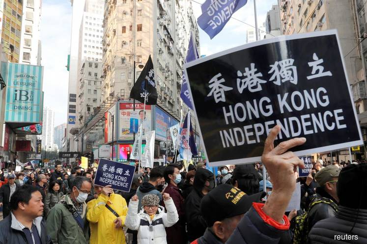 """Thousands march in Hong Kong against China """"repression"""" after grim 2018"""