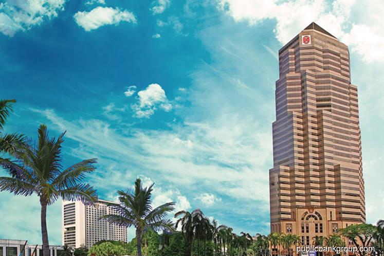 Public Bank falls, outpacing losses in KLCI