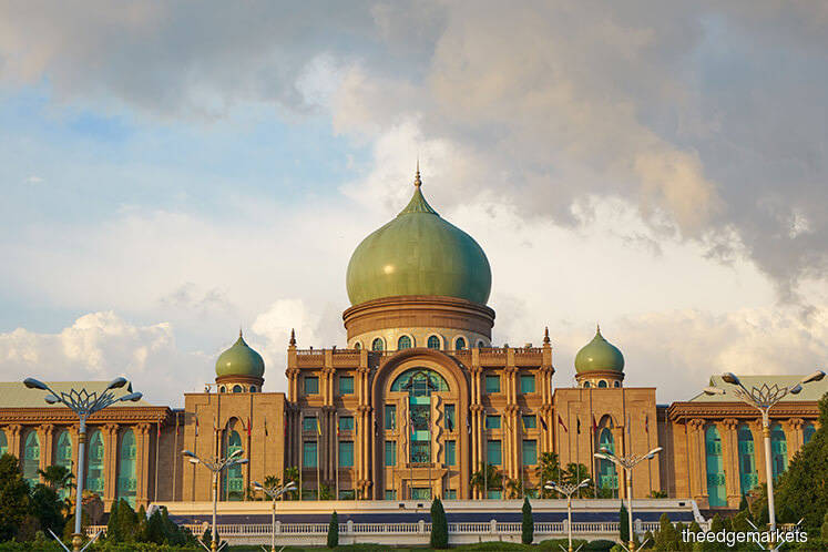 Putrajaya to review commitment to reducing carbon emission