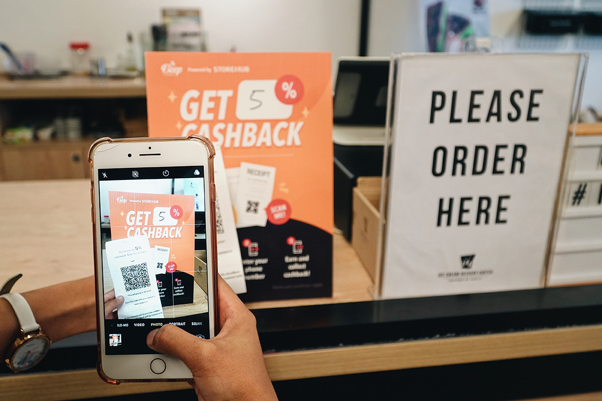 A user scanning the Beep QR Order, a feature offered by StoreHub