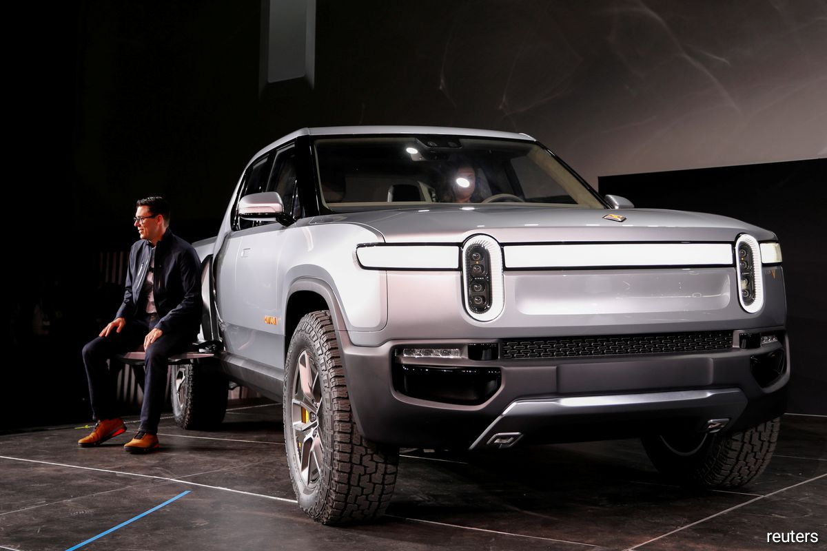 R.J. Scaringe, Rivian's CEO, introduces his company's R1T all-electric pickup truck at Los Angeles Auto Show in Los Angeles, California, U.S. November 27, 2018.