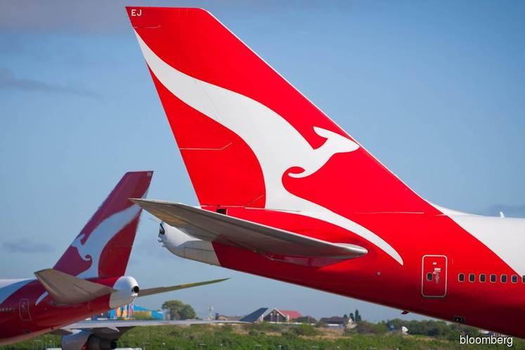 Qantas slashes international capacity by 23% as virus bites
