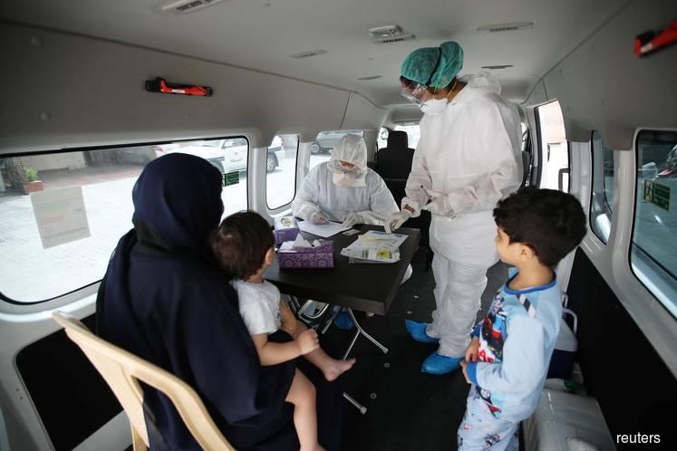 Qatar and Bahrain record jump in coronavirus cases, Kuwait bans flights