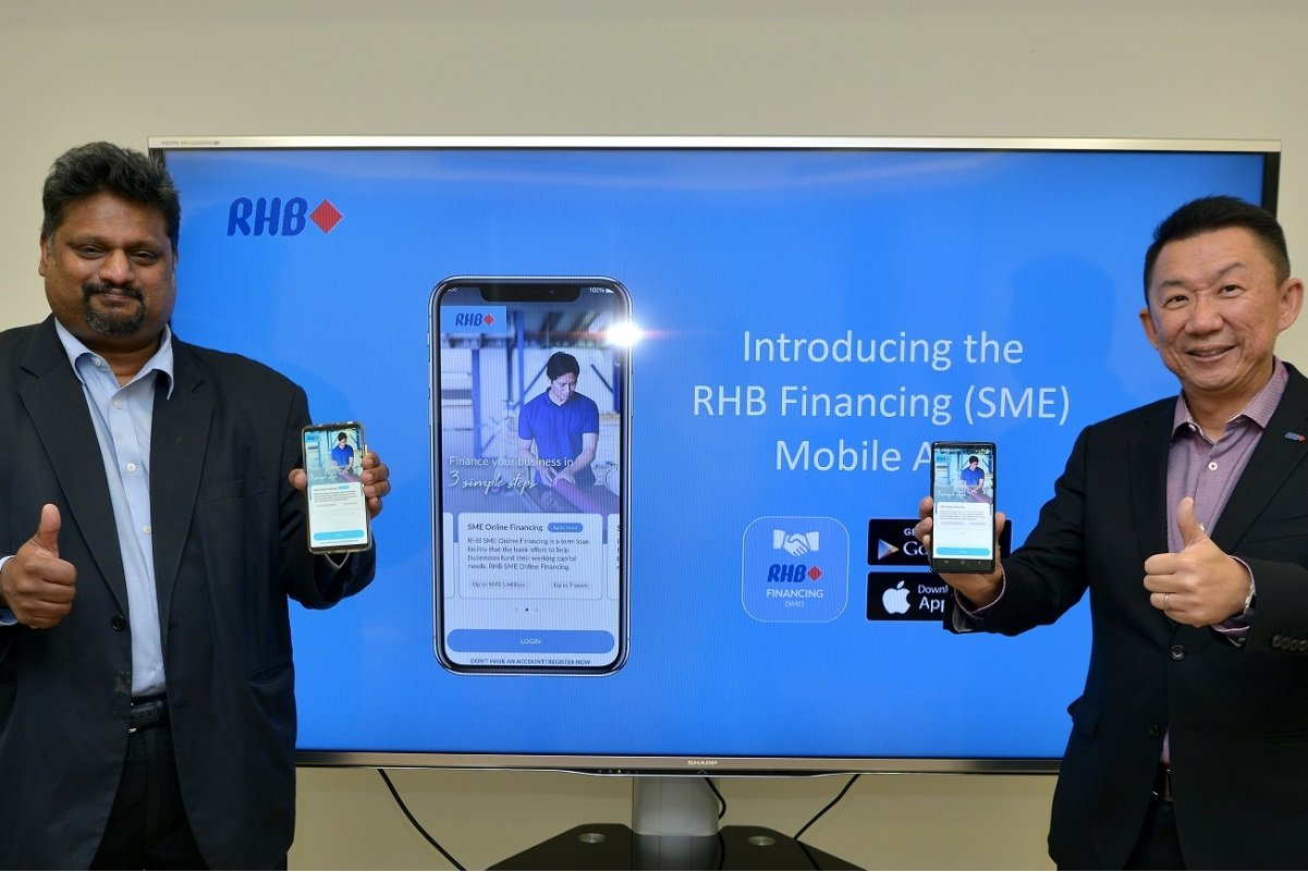 RHB Banking Group group chief digital and technology officer Rohan Krishnalingam (left) and RHB Banking Group head of group business and transaction banking Jeffrey Ng at the launch of Malaysia's first SME Financing Mobile App powered by artificial intelligence.