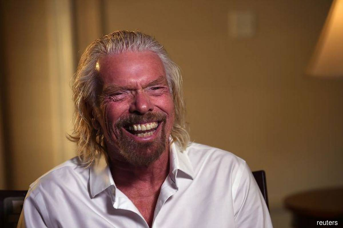 Virgin Galactic's Branson to fly into space in early 2021
