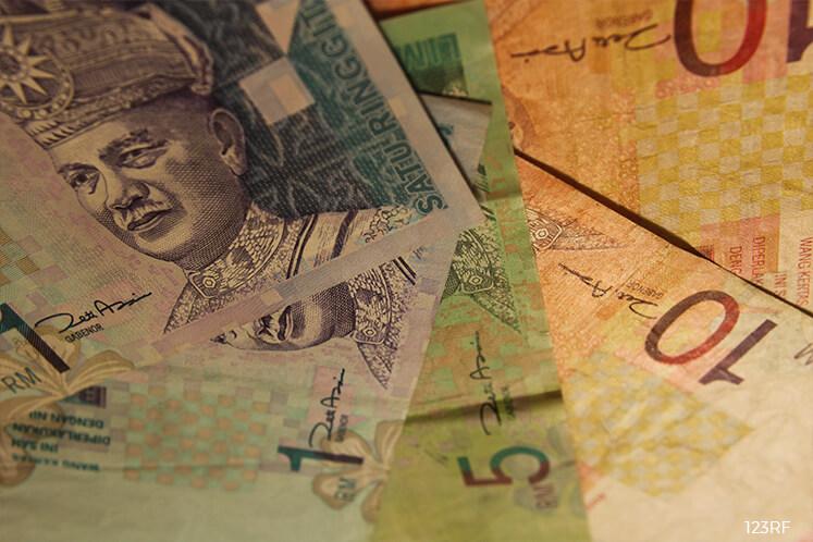 Ringgit stalls near 2-week high as dollar gains